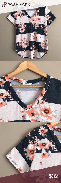 Floral Blush & Navy V-Neck Top Such a cute and casual top, in excellent condition. Hangs long so it can easily be worn with leggings! Very light pilling, mostly on the sides under the arms. Twenty Ten Tops