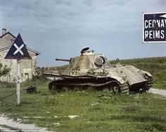 A destroyed German Panzer tank lies next to a road in Belgium in 1947. Hitler's feared Panzer divisions were a hallmark of Germany's rapid gains across Europe in the early stages of the war by using an innovative strategy known as blitzkrieg - which translates to 'lightning war'