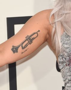 Whose famous Trumpet tattoo is this? Lady Gaga's, of course, a nod of admiration to Tony Bennett.