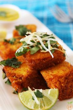 Spicy Khaman Dhokla is a classic Gujarati dish with a sponge like texture and flavored with a spicy tempering and lemon. Khaman Dhokla is one kind of dhokla Veg Recipes, Indian Food Recipes, Cooking Recipes, Healthy Recipes, Ethnic Recipes, Cooking Tips, Starter Recipes, Recipies, Snack Recipes