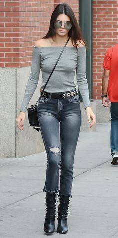 Kendall Jenner got the cool-girl look down pat. She toughened up her street style with an off-the-shoulder gray top and distressed charcoal cropped denim. Her accessories, too, played on the theme, including mirrored aviators, a mini cross-body, a studded belt, and buckled midi boots.