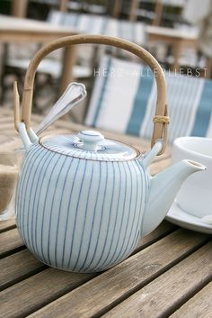 White and blue striped tea pot.*
