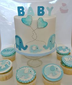 Baby boy elephant baby shower cake with matching elephant cupcakes. See my Facebook Page Driving Me Cakey for more photos of my work. Located in Fairview Park South Australia.