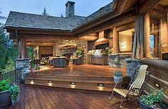 This gorgeous wood and stone home has a beautiful two-layer deck a fireplace and stove. Lovely! (Walt Landi Signature Homes)