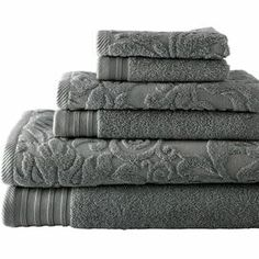 """Showcasing a scrolling jacquard design, this Egyptian cotton towel set completes your master bath with the perfect blend of form and function.    Product: 2 Bath towels, 2 hand towel and 2 washclothsConstruction Material: 100% Egyptian cottonColor: PlatinumFeatures:  Elegant jacquard design600 GSMPlush and extra absorbent Dimensions: Bath Towel: 28"""" x 54""""Hand Towel: 16"""" x 28""""Washcloth: 13"""" x 13""""Cleaning and Care: Machine washable"""