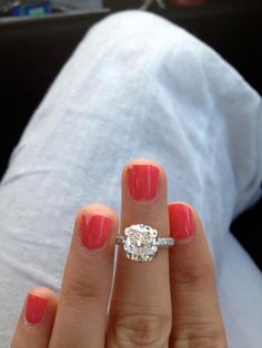 3 carat colorless, cushion cut center stone, 3 sided mico pave diamond band.  Beautiful