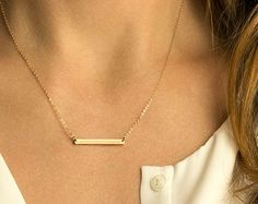 Perfect Bar Necklace in 14K Gold Fill, Rose Gold Fill or Sterling Silver. Personalize your Perfect Bar Necklace or leave it blank. Our signature bar size has a lovely, balanced proportion and looks beautiful suspended from our signature delicate chain. *2nd photo shows 3 separate pieces. This listing is just for the 1 bar necklace (see photo 2).   Necklace: The PERFECT Bar Necklace - 140_35_H Bar  - Choose your necklace length, color and bar texture. - The Perfect sized bar at 35 x 4mm is…