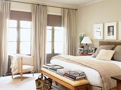 """This all-neutral bedroom is the epitome of soft and simple. With simple white bed linens, an upholstered headboard, and gauzy linen drapes, the varying textures keep the many shades of beige and brown from being boring."""