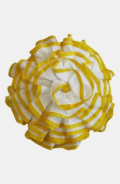 Cancan ruffles with a sunny streak bring ebullient dimension to a circular pillow.