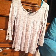 Long sleeve white & grey with half laced sleeves. White & grey long sleeves with pocket & half laced sleeves(pictures) Only worn once, didn't fit me right. lily rose Other