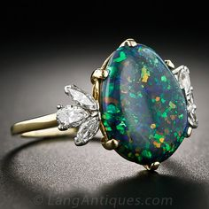 Lang Antiques- I looove this setting, and the opal is nice, but I'm thinking a big pretty emerald instead :)