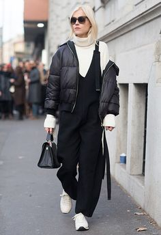 Weekend getaway outfit = unlocked. Start with the ultimate Scandi staple, the cream ribbed roll-neck, and layer it under an oversized minimal jumpsuit. Add the jacket of the season in classic black (oh hey, puffer) and finish off with clean white wear-with-anything sneaks