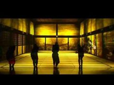 AMAZING!  Japanese performers dancing in perfect  synchronization to a beautiful with a projected video.