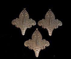 Set of 3 brass fleur de lis by themetalworx on Etsy, $2.50