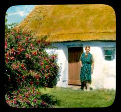 Connemara: woman in front of a cottage, by a large fuschia bush :: Branson DeCou Digital Archive Ireland Pictures, Old Pictures, Ireland People, Irish Cottage, Digital Archives, Old Photography, Connemara, Big Family, Ireland Travel