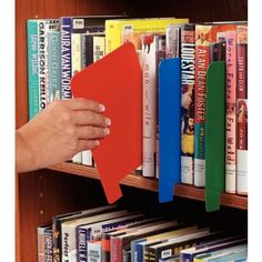 Slip our Library Shelf Markers in wherever you remove a book. Also great for directing staff and visitors to new book sections, markers extend beyond material to remain visible. Made of durable plastic, these markers are eas Bookshelf Organization, Library Shelves, Library Displays, Library Books, Classroom Organization, Bookshelves, Library Ideas, Organizing Books, Book Dividers