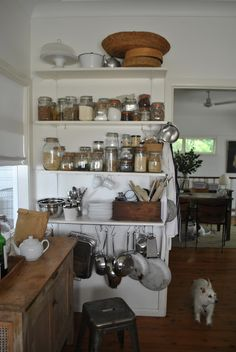 I especially am fond of the lower shelf where all the pans are hanging from hooks. Really nice use of a small space.