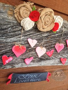 fun valentine s day decorating project to do with kids, crafts, seasonal holiday d cor, valentines day ideas, The burlap roses tutorial on blog are attached with velcro so this board can be used throughout the year We ll make more salt dough cutouts for each season