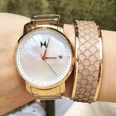 Gold wrist pieces.