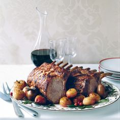 Citrus-Marinated Pork Rib Roast Recipe from Food & Wine.Perfect Christmas Roast: Chef Fabio Trabocchi infuses this pork roast with flavor by stuffing garlic cloves into the fatty side of the roast and marinating the meat with fresh herbs and citrus. Marinated Pork Ribs, Pork Rib Roast, Rib Roast Recipe, Roast Recipes, Wine Recipes, Recipes Dinner, Dinner Ideas, Italian Christmas Dinner, Christmas Roast