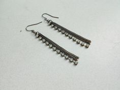 a pair of dangle pierced vintage earrings strands of glass rhinestones and strands of chains vintage earrings from the very very early 1990s sweet bling bling for your ears  These french loop earrings are each 2 7/8 long quite simple in design, just enough flash, a little western
