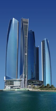 Futuristic Architecture, Etihad Towers, Abu Dhabi by DBI Design #architecture #Design #build #building #architectural #architect #elegant