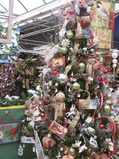 Fully decorated tree with ribbons, snowmen, garland, ornaments, deer, Santa and more From the Vintage Christmas Theme at Your Christmas Shop at Stauffers of Kissel Hill Garden Centers. (www.skh.com)