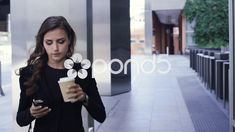 Attractive business woman commuter using smartphone walking in city of london Stock Footage,#commuter#smartphone#woman#Attractive