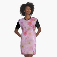 -  Graphic T-shirt Dress.   -  Sublimation printed 96% polyester, 4% elastane front panel.   -  Solid color 100% cotton back/sleeves/rib.   -  Loose casual fit. . . . #dress  #loosefitdress  #tshirtdress  #bitsofeverywhere  #cherryblossoms  #pinkflowers  #flowers