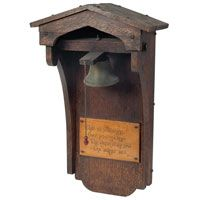 """Arts and Crafts dinner bell, peaked top over a brass bell and motto that reads: """"That all softening, over-powering knell, the tocsin of the soul - the dinner bell. Byron,"""" some separation, original finish, 12.5""""w x 7""""d x 21""""h,"""
