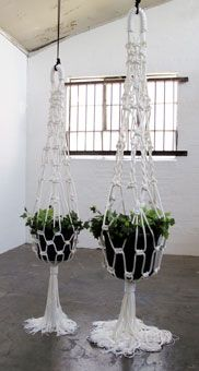 Oversized hanging pots in Macramé. A nice idea for an event perhaps.
