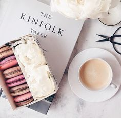 The perfect pastime. Eating macaroons, while reading a book and sipping tea or a latte.