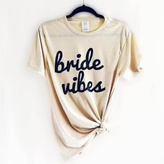 Bride Vibes Tee - Say bye to single life and hello to married life! This bride tee makes a great addition to your wardrobe while you're planning your dream wedding!