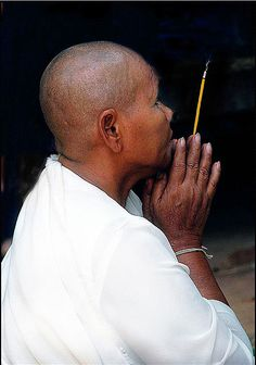 ^Buddhist monk at prayer...by Glosack , flickr