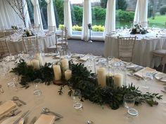 Wedding Top Table Floral Arrangement on a Wooden Log Base
