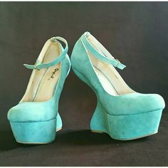 Turquoise Heel-Less Platform Shoes Super cute,  worn only twice. Micro suede. Runs a little small, more like a size 5. Unnoticeable, slight wear on toe tips (could only be seen when close up). Color is slightly darker than pictured (please note that your screen monitor may slightly differ in color) Qupid Shoes Platforms