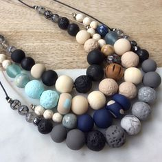 Beautiful and unique handcrafted necklaces, a combination of wooden beads, ceramic, resin, gemstone and handmade polymer clay beads.