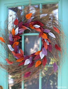 Felt Leaf Wreath Tutorial: Burnt orange, maroon, purple, and blue leaves come together beautifully to make this door decoration.