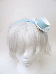 OKAY.....I'm not really getting this! Could someone explain why you would wear a teacup on your head? LOL