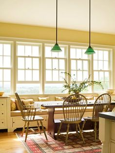 LOVE the built-in window bench, lots of windows, farmhouse table, and lighting, cream walls