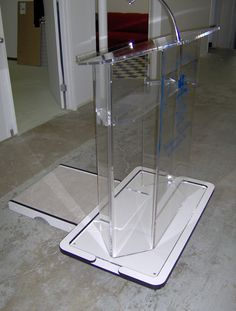 Podium with custom walk-up for The Portuguese Association  - Created by Acryl Design