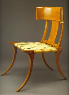 """This Klismos chair by T.H. Robsjohn Gibbings, was based on a 5th Century BC design Gibbings found on a marble gravestone. He said, """"It is to furniture what the Parthenon is to architecture."""" The Klismos chair pictured, in Greek walnut and strap leather was part of his 1961 'Furniture of Classical Greece' collection. It is Gibbings' best known piece of furniture."""