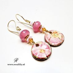 Handmade artisan earrings with ceramic flower charms and lampwork glass beads.