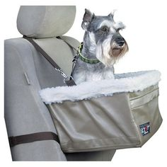 Pet booster seat with a removable interior liner and zippered front pocket. Includes two safety leashes.   Product: Pet booster ...