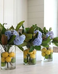 vases with magnolia leaves, blue hydrangeas, lemons and limes add a bright sprign touch to the space Summer Flower Arrangements, Summer Flowers, Floral Arrangements, Diy Flowers, Purple Flowers, Flowers Vase, Fake Flowers, Beautiful Flowers, Flowers Garden