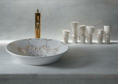 Decorative architecture and Moorish style define the distinctive Persia pattern. Striking open linework contrasts with geometric patterns, giving this Conical Bell sink its finely detailed look.