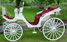 Victorian Carriage with red seats - would love to arrive at and leave my wedding In this.