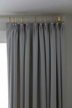 acrylic drapery rod with euro pleated drapery