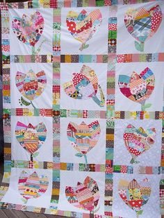 Foundation-pieced tulip quilt by Penny of sewtakeahike (and other quilting bee members). Scrappy, paper-pieced string quilt.