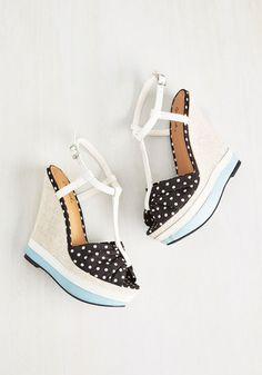Step out in these black-and-white dotted wedges and incite some excitement! A medley of lively details, like a ruched peep toe, a white, vegan faux-leather T-strap, a fabric-wrapped wedge, and sky blue trim, give this pair marvelous verve.